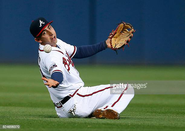Daniel Castro of the Atlanta Braves bobbles the pop fly of Mookie Betts of the Boston Red Sox as he catches it for the out during the fourth inning...