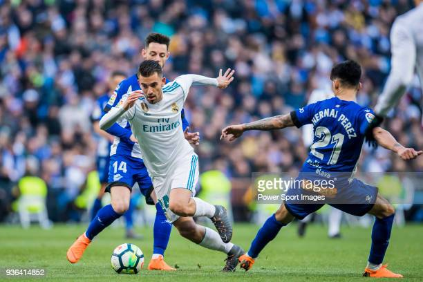 Daniel Ceballos Fernandez D Ceballos of Real Madrid fights for the ball with Jorge Franco Alviz Burgui and Hernan Arsenio Perez of Deportivo Alaves...