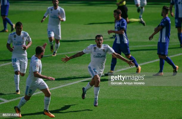 Daniel Ceballos of Real Madrid CF celebrates scoring their opening goal with teammate Daniel Carvajal during the La Liga match between Deportivo...
