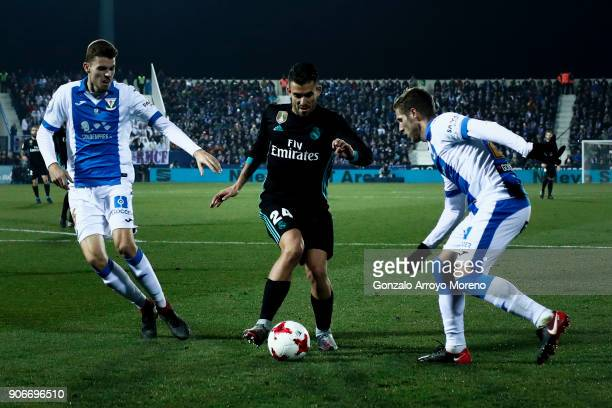 Daniel Ceballos of Real Madrid CF competes for the ball with Ruben Perez and his teammate Gerard Gumbau of Deportivo Leganes during the Copa del Rey...
