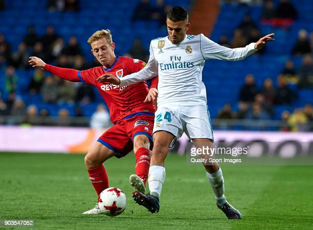 Daniel Ceballos of Real Madrid competes for the ball with Dani Nieto of Numancia during the Copa del Rey Round of 16 second Leg match between Real...