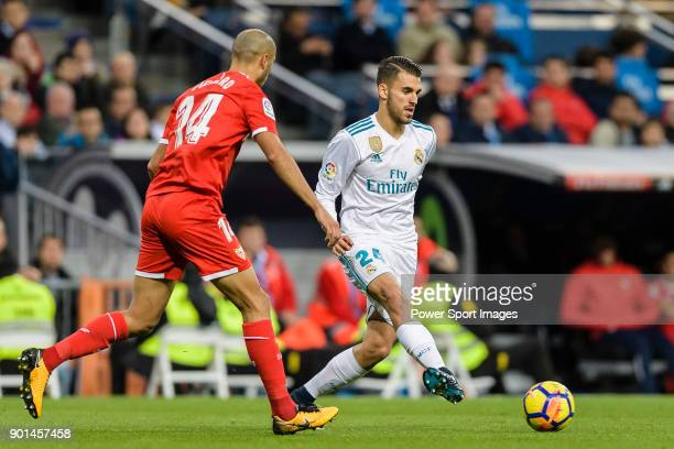 Daniel Ceballos of Real Madrid in action against Guido Pizarro of Sevilla FC during La Liga 201718 match between Real Madrid and Sevilla FC at...