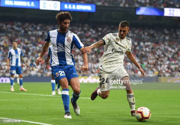 Daniel Ceballos of Real Madrid is challenged by Esteban Granero of RCD Espanyol during the La Liga match between Real Madrid CF and RCD Espanyol at...