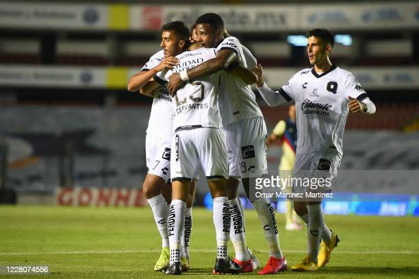Daniel Cervantes of Queretaro celebrates with teammates after scoring the second goal of his team during the 5th round match between Queretaro and...
