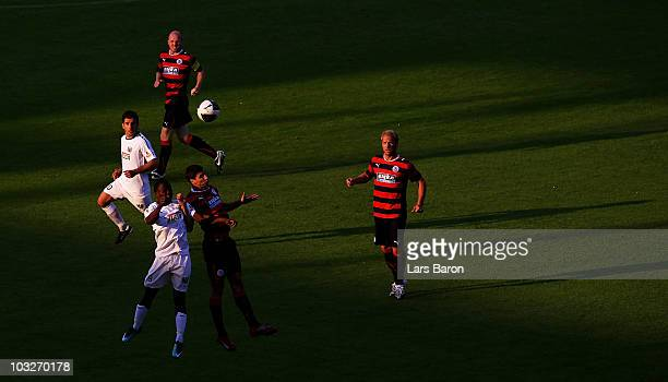 Daniel Chitsulo of Muenster goes up for a header with Silvio Pagano of Wuppertal during the Regionalliga West match between Wuppertaler SV and...