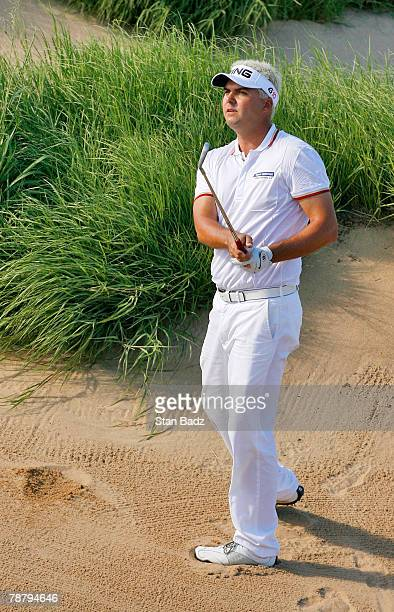 Daniel Chopra hits out of the bunker at the 9th hole during the fourth round of the Mercedes-Benz Championship at the Plantation Course at Kapalua on...