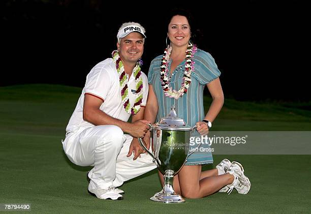 Daniel Chopra of Sweden and his wife Samantha Chopra pose with the trophy after winning the Mercedes- Benz Championship on at the Plantation Course...