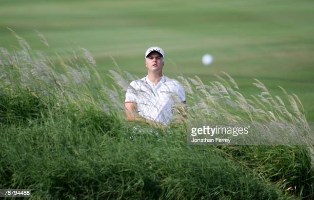 Daniel Chopra watches his shot out of the sand trap on the 9th hole during the final round of the Mercedes-Benz Championship at the Plantation Course...