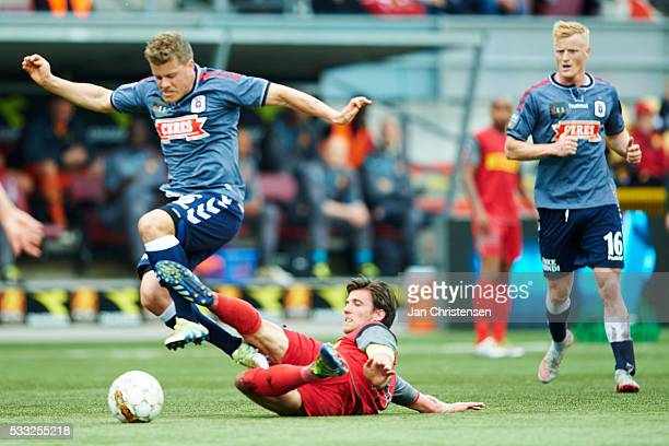 Daniel Christensen of AGF Arhus and Martin Vingaard of FC Nordsjalland compete for the ball during the Danish Alka Superliga match between FC...