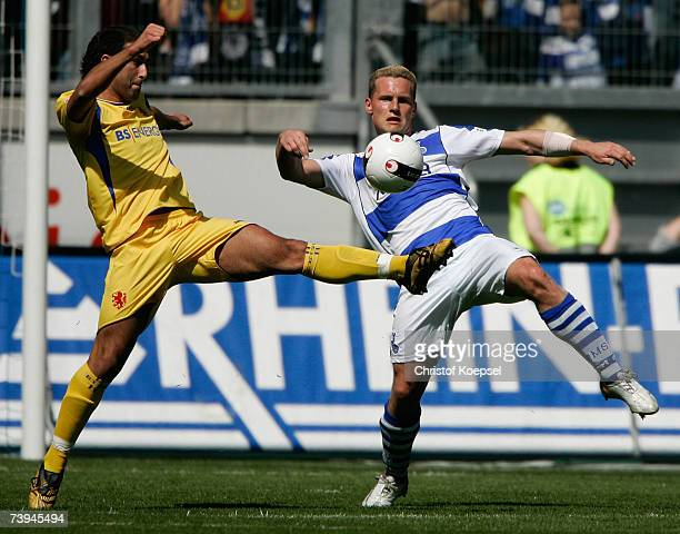 Daniel Cimen of Braunschweig tackles Markus Kurth of Duisburg during the Second Bundesliga match between MSV Duisburg and Eintracht Braunschweig at...