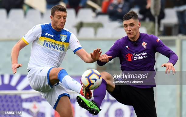 Daniel Ciofani of Frosinone Calcio competes for the ball with Nikola Milenkovic of ACF Fiorentina during the Serie A match between ACF Fiorentina and...