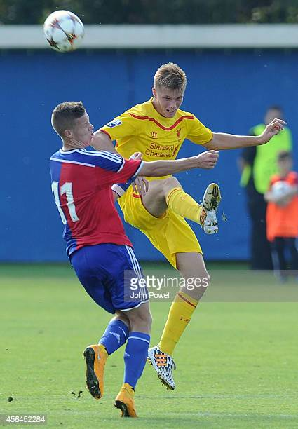 Daniel Cleary of Liverpool competes with Cedric Itten of FC Basel 1893 during the UEFA Youth League match between FC Basel 1893 Under 19s and...