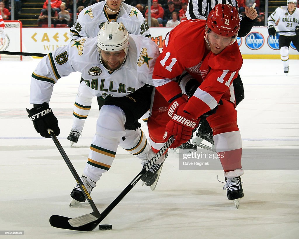 Daniel Cleary #11 of the Detroit Red Wings and Trevor Daly #6 of the Dallas Stars battle for the puck during an NHL game at Joe Louis Arena on January 29, 2013 in Detroit, Michigan.