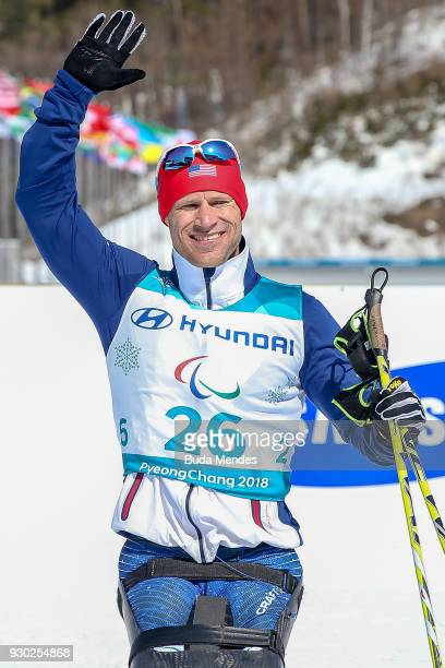 Daniel Cnossen of the United States celebrates after after crossing the finish line in second place during the Men's CrossCountry 15km Sitting event...