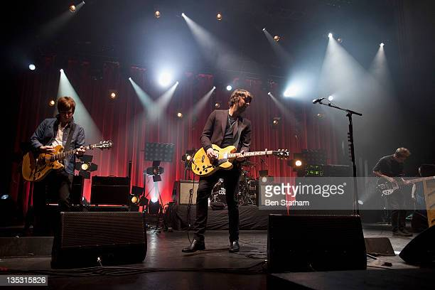 Daniel Conan Moores Liam Fray and Mark Cuppello of The Courteeners performs on stage at Manchester Apollo on December 8 2011 in Manchester United...