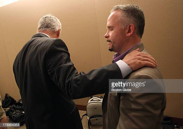 Daniel Conley and Casey Sherman nephew of murder victim Mary Sullivan say goodbye after the press conference Suffolk County District Attorney Daniel...