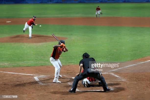 Daniel Cooper throw the ball and Jiandido Tromp hits the ball during the Baseball match Baseball European Championship 2021 - Quarter finals -...