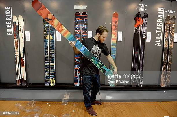 Daniel Coppa of Liberty Skis sets up a display while preparing for the SIA Snow Show at the Colorado Convention Center in Denver CO on January 28...