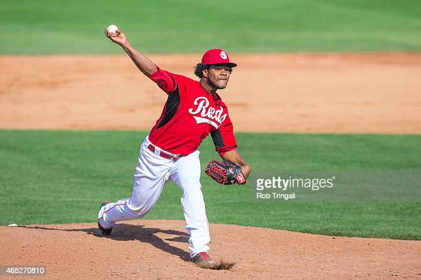Daniel Corcino of the Cincinnati Reds pitches during a spring training game against the Cleveland Indians at Goodyear Ballpark on March 3 2015 in...