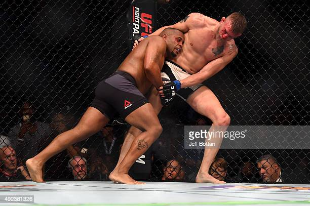 Daniel Cormier attempts a takedown against Alexander Gustafsson in their UFC light heavyweight championship bout during the UFC 192 event at the...