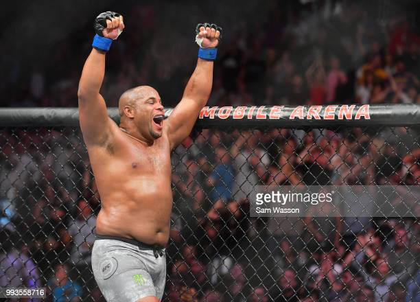 Daniel Cormier celebrates after defeating Stipe Miocic by knockout in the first round of their heavyweight championship fight at TMobile Arena on...