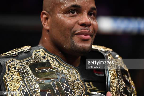 Daniel Cormier celebrates after his submission victory over Derrick Lewis in their UFC heavyweight championship bout during the UFC 230 event inside...