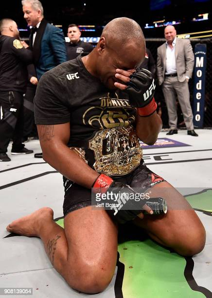 Daniel Cormier celebrates after his TKO victory over Volkan Oezdemir of Switzerland in their light heavyweight championship bout during the UFC 220...