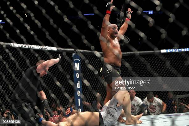 Daniel Cormier celebrates his defeat of Volkan Oezdemir by knockout for the light heavyweight championship belt during UFC 220 at TD Garden in Boston...