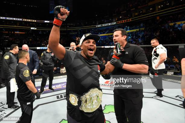Daniel Cormier celebrates his rear choke submission victory over Anthony Johnson in their UFC light heavyweight championship bout during the UFC 210...