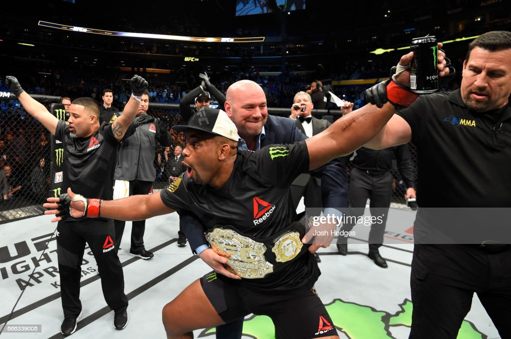 Daniel Cormier celebrates his rear choke submission victory over Anthony Johnson in their UFC light heavyweight championship bout during the UFC 210 event at KeyBank Center on April 8, 2017 in Buffalo, New York.