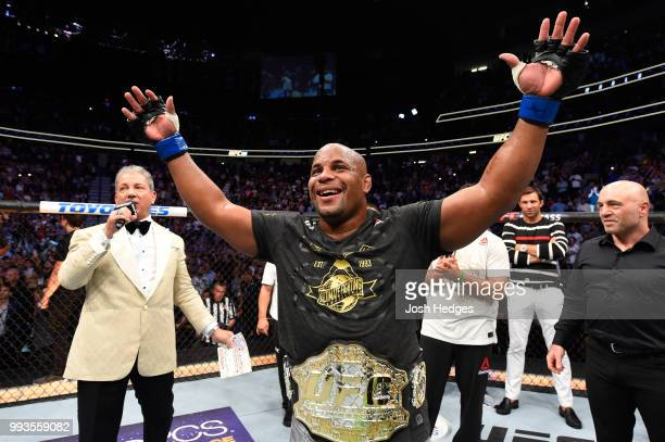 Daniel Cormier celebrates his victory over Stipe Miocic in their UFC heavyweight championship fight during the UFC 226 event inside T-Mobile Arena on...