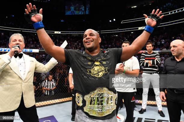 Daniel Cormier celebrates his victory over Stipe Miocic in their UFC heavyweight championship fight during the UFC 226 event inside TMobile Arena on...
