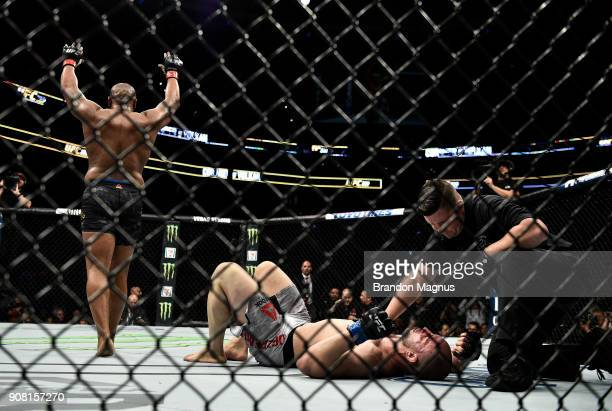 Daniel Cormier celebrates his victory over Volkan Oezdemir of Switzerland in their light heavyweight championship bout during the UFC 220 event at TD...