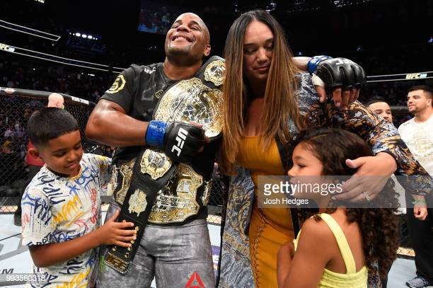 Daniel Cormier celebrates with family inside the Octagon after his UFC heavyweight championship fight during the UFC 226 event inside TMobile Arena...