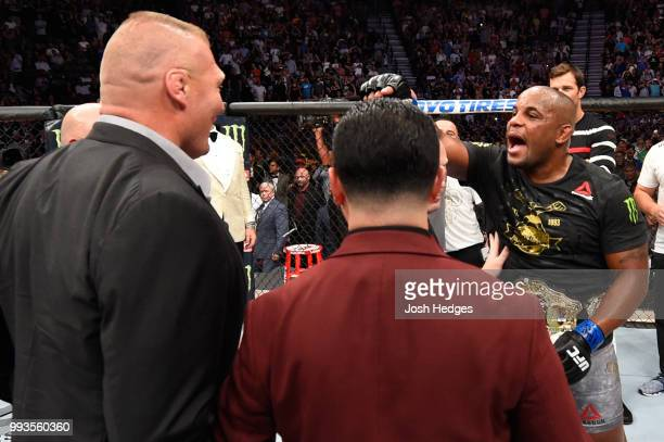 Daniel Cormier confronts Brock Lesnar after his UFC heavyweight championship fight during the UFC 226 event inside TMobile Arena on July 7 2018 in...