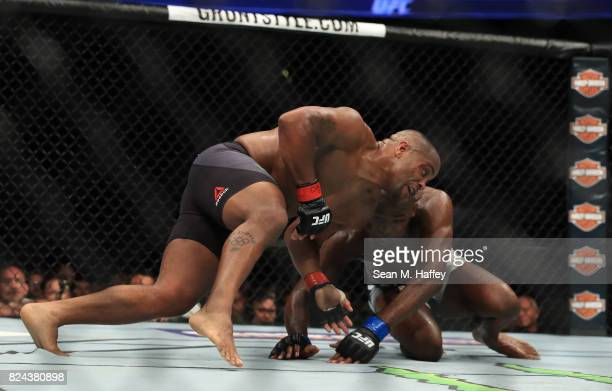 Daniel Cormier defends a takedown attempt by Jon Jones during the UFC 214 event at Honda Center on July 29, 2017 in Anaheim, California.
