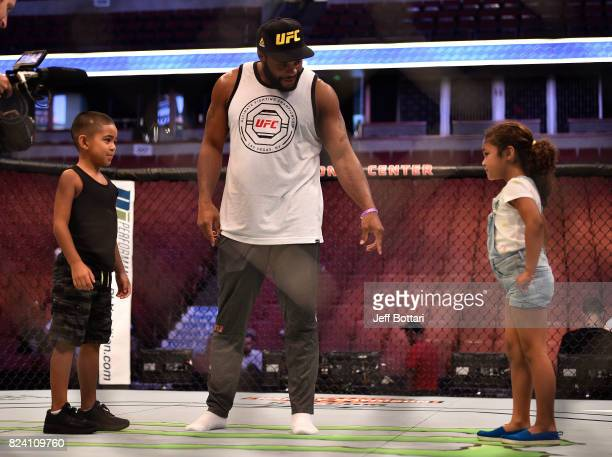 Daniel Cormier interacts with his kids backstage during the UFC 214 weighin inside the Honda Center on July 28 2017 in Anaheim California
