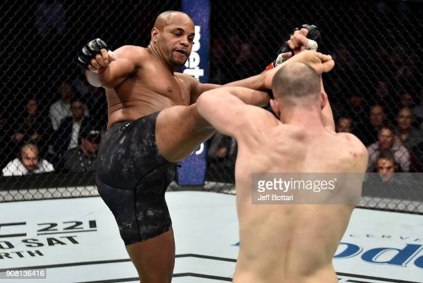 Daniel Cormier kicks Volkan Oezdemir of Switzerland in their light heavyweight championship bout during the UFC 220 event at TD Garden on January 20...