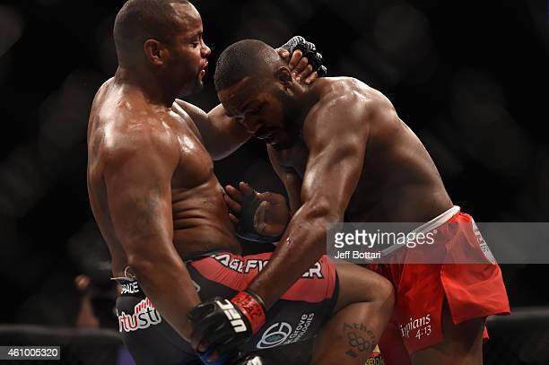 Daniel Cormier knees Jon Jones in their UFC light heavyweight championship bout during the UFC 182 event at the MGM Grand Garden Arena on January 3...