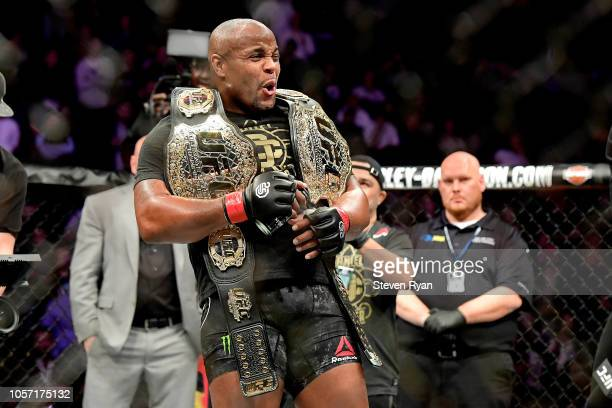 Daniel Cormier of the United States celebrates his victory over Derrick Lewis of the United States in their heavyweight title bout during the UFC 230...