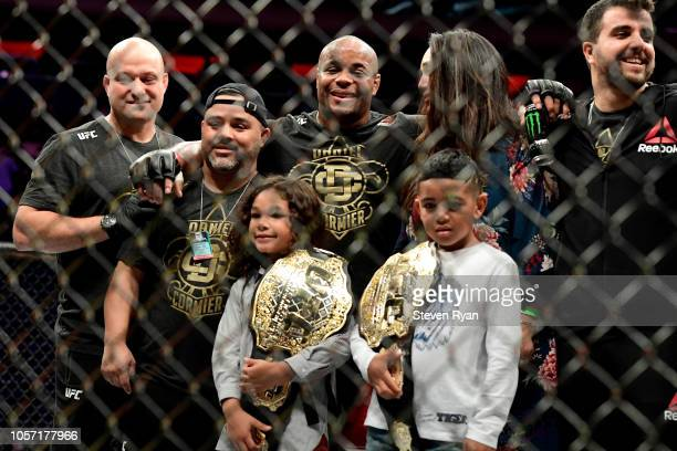Daniel Cormier of the United States celebrates with his family and team after his win by submission over Derrick Lewis of the United States in their...