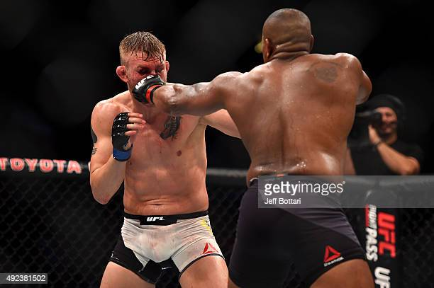 Daniel Cormier punches Alexander Gustafsson in their UFC light heavyweight championship bout during the UFC 192 event at the Toyota Center on October...