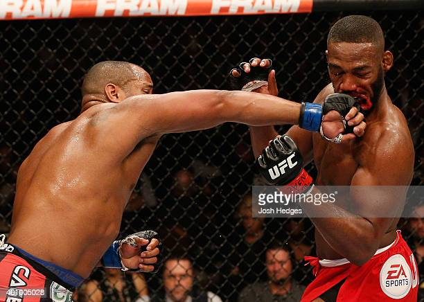 Daniel Cormier punches Jon Jones in their UFC light heavyweight championship bout during the UFC 182 event at the MGM Grand Garden Arena on January 3...