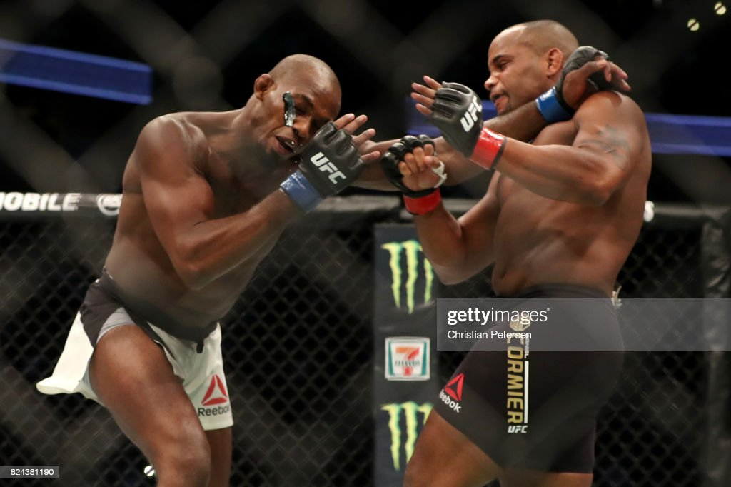 Daniel Cormier punches Jon Jones in their UFC light heavyweight championship bout during the UFC 214 event at Honda Center on July 29, 2017 in Anaheim, California.