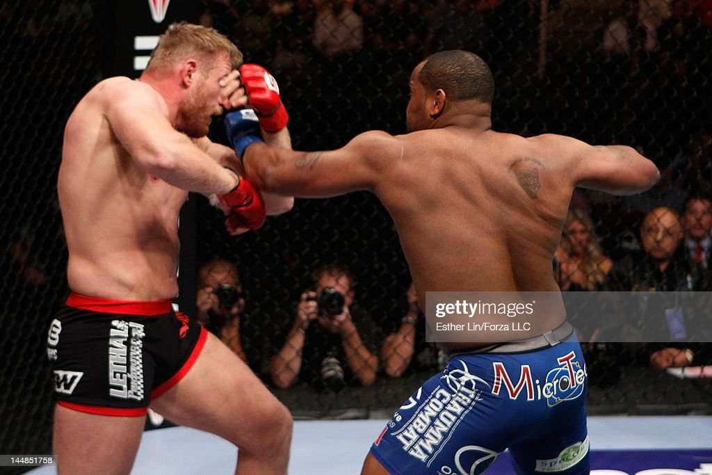 Daniel Cormier punches Josh Barnett during the Strikeforce event at HP Pavilion on May 19, 2012 in San Jose, California.
