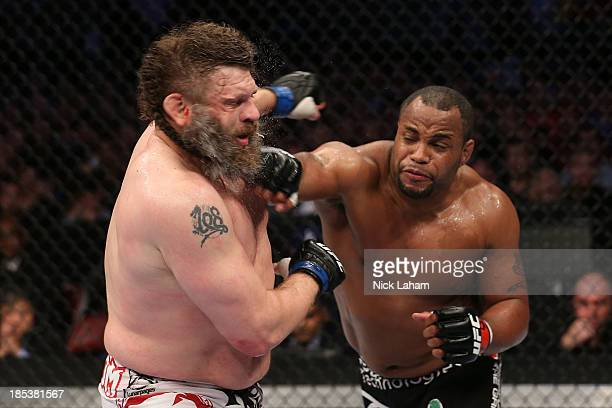 Daniel Cormier punches Roy 'Big Country' Nelson in their UFC heavyweight bout at the Toyota Center on October 19 2013 in Houston Texas