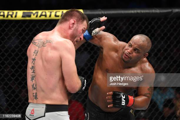 Daniel Cormier punches Stipe Miocic in their heavyweight championship bout during the UFC 241 event at the Honda Center on August 17, 2019 in...