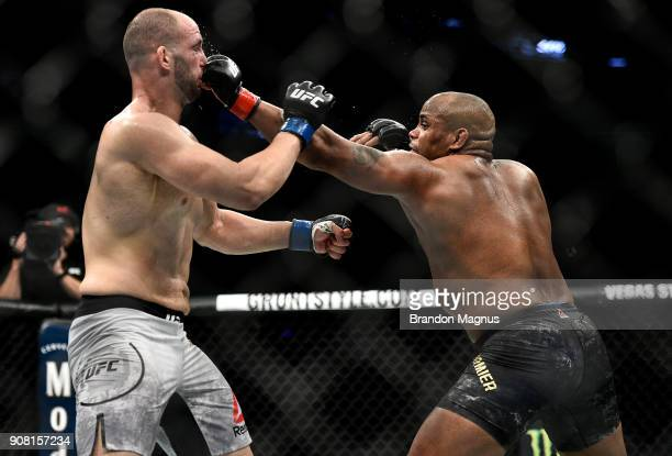 Daniel Cormier punches Volkan Oezdemir of Switzerland in their light heavyweight championship bout during the UFC 220 event at TD Garden on January...