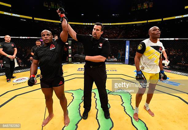 Daniel Cormier reacts to his victory over Anderson Silva of Brazil in their light heavyweight bout during the UFC 200 event on July 9 2016 at TMobile...