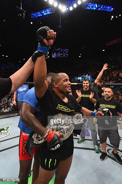 Daniel Cormier reacts to his victory over Anthony Johnson in their UFC light heavyweight championship bout during the UFC 187 event at the MGM Grand...